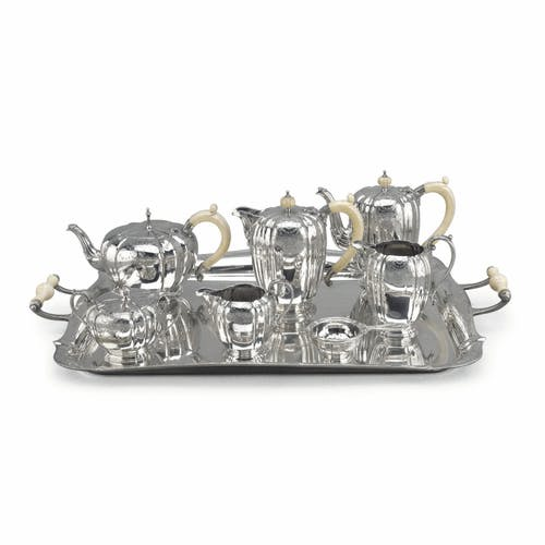 A seven piece Elizabeth II silver tea set and tray, Garrard & Co. Ltd., Birmingham, 1962